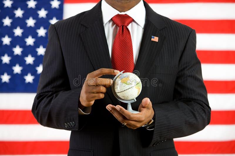 Politiker: Rymma ett jordklot i hans händer royaltyfria bilder