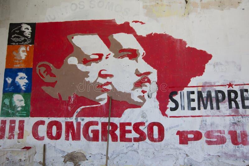 Politisk grapffiti av Hugo Chavez och Nicolas Maduro på en vägg royaltyfri fotografi