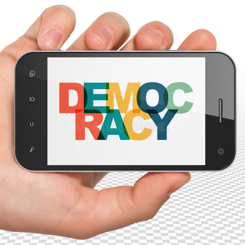 Polityki pojęcie: Ręka Trzyma Smartphone z demokracją na pokazie royalty ilustracja
