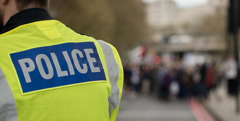 Polizei unterzeichnet auf Jacke lizenzfreies stockfoto
