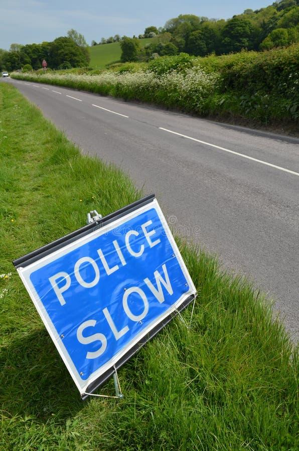 Polizei verlangsamt Zeichen lizenzfreie stockbilder