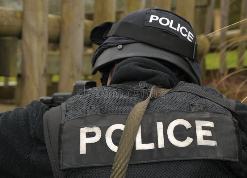 POLIZEI-Zeichen auf FLIEGENKLATSCHE-Uniform lizenzfreies stockfoto