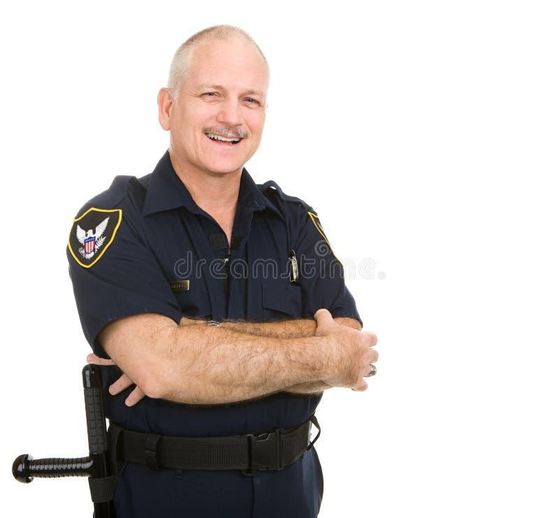 Polizeibeamte - Lächeln lizenzfreie stockfotografie