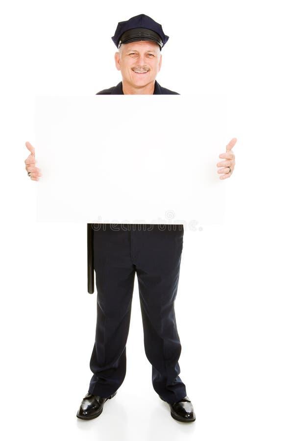 Polizeibeamte Mit Zeichen Stockfotografie