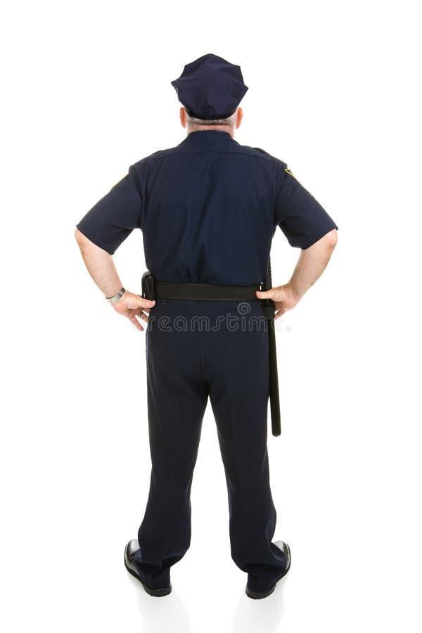 Polizeibeamte-volle Karosserien-Rückseite stockbild