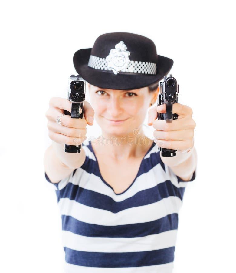 Polizeibeamtin mit Gewehren stockbild