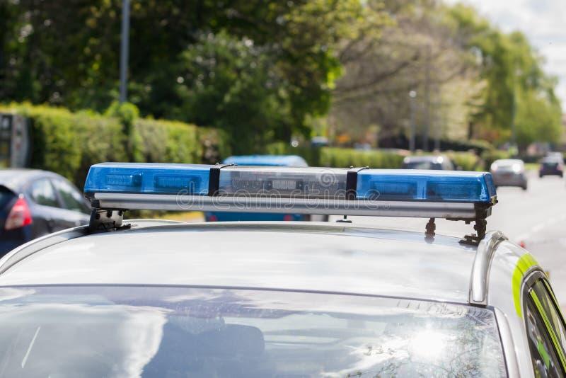 Polizeiwagen und Verkehr stockfotografie