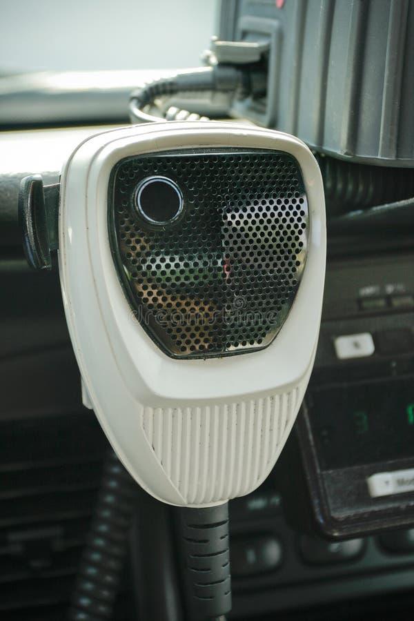 Polizia Mic radiofonico in automobile immagine stock