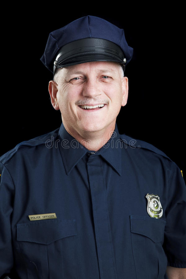 Poliziotto amichevole sul nero immagine stock