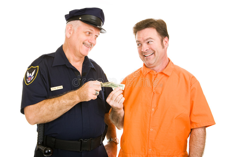 Polizist nimmt Bestechungsgeld an stockfotografie