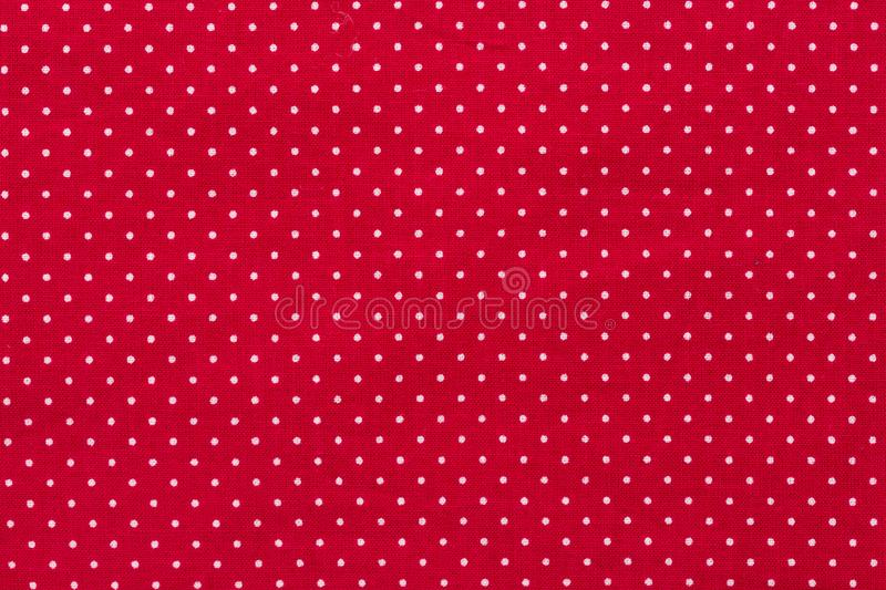 Polka dot on red canvas cotton texture, fabric background stock photo