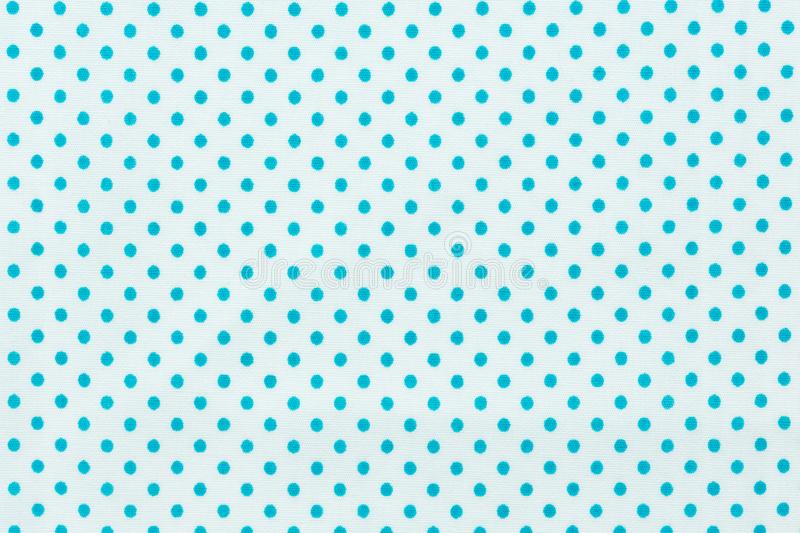 Polka dots in white and blue pattern fabric. stock photography