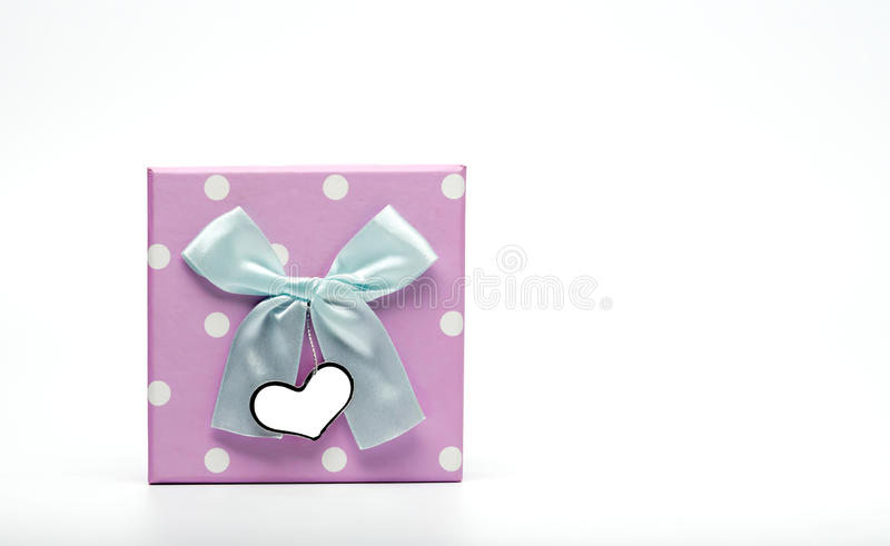 Polka dotted gift box with pale green ribbon bow and blank greeting card isolated on white background, just add yo royalty free stock images