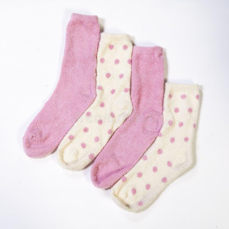 Polka gestippelde sokken op witte achtergrond royalty-vrije stock foto's