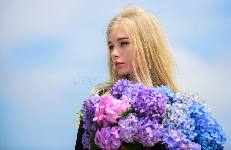 Pollen allergy. Gentle flower for delicate woman. Girl tender blonde hold hydrangea flowers bouquet. Allergy free life. Stop allergy blooming season. Enjoy stock photo