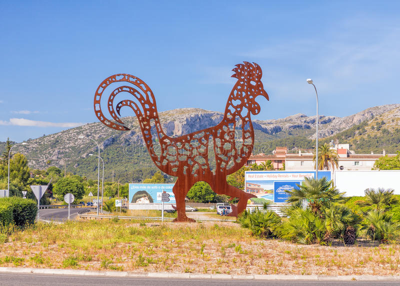 The Pollensa Cockerel, Mallorca. This huge flame-cut steel cockerel, the symbol of Pollensa, is the centre piece of the towns main roundabout stock photo