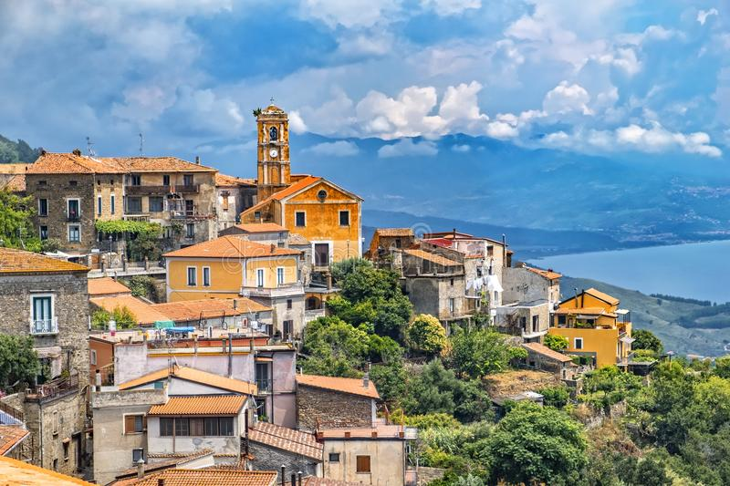 Pollica at national park Cilento. Picturesque shot of historic village Pollica at the Cilento national reserve in Italy. The background shows the coastline of stock photos