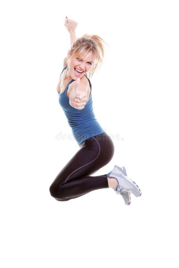 Pollice di salto della donna su immagine stock