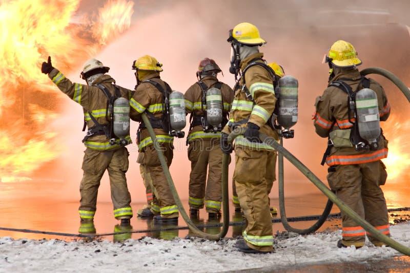 Pollici del pompiere in su fotografie stock