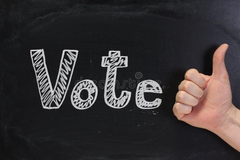 Pollici di voto in su immagini stock
