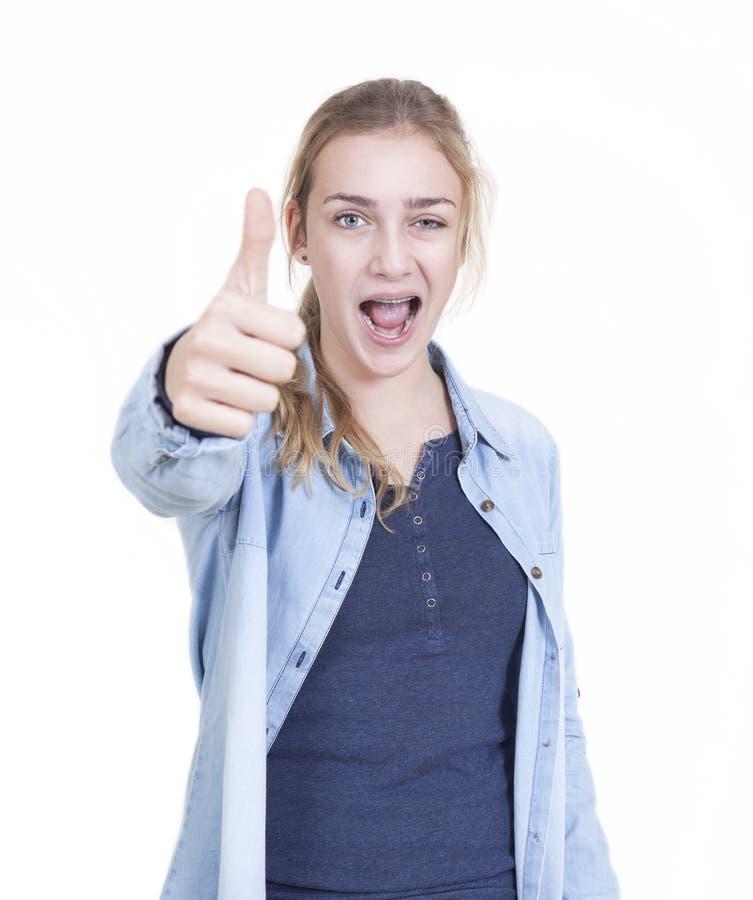 Pollici giovanili della ragazza su immagini stock