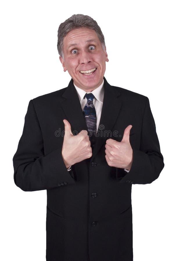 Pollici sorridenti felici dell'uomo dell'uomo d'affari in su isolati immagine stock libera da diritti