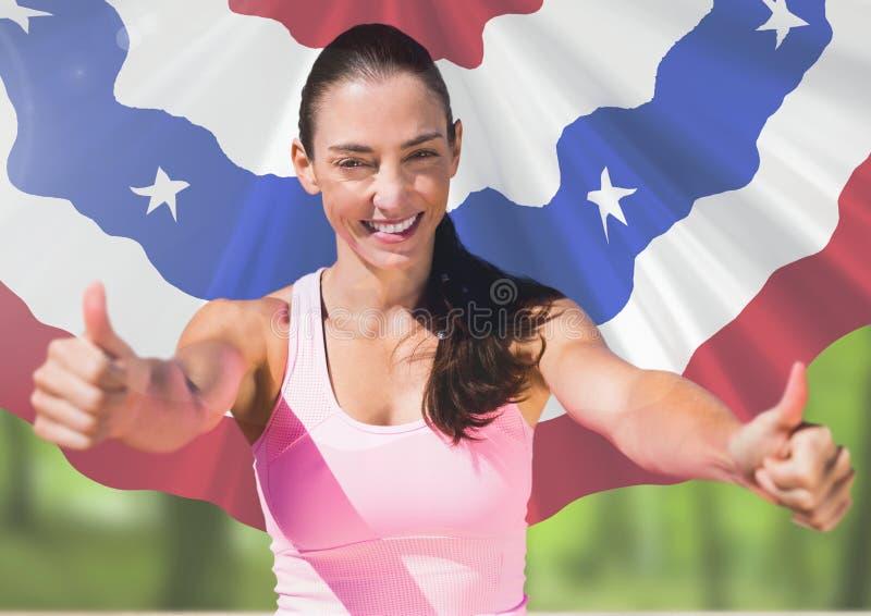 Pollici sportivi della donna su contro la bandiera americana fotografia stock
