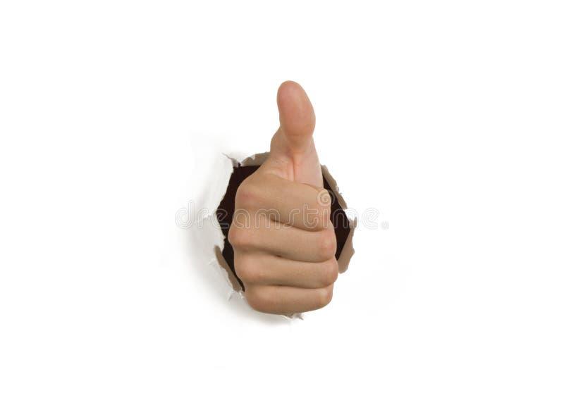 Pollici sulla mano di successo che attraversa la parete immagine stock