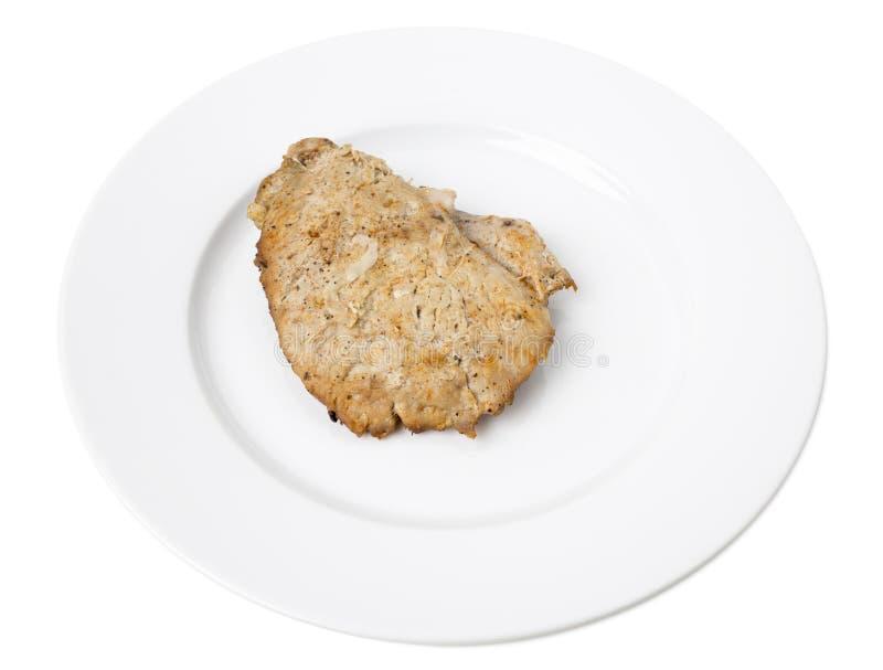 Pollo al forno delizioso in un piatto bianco fotografie stock