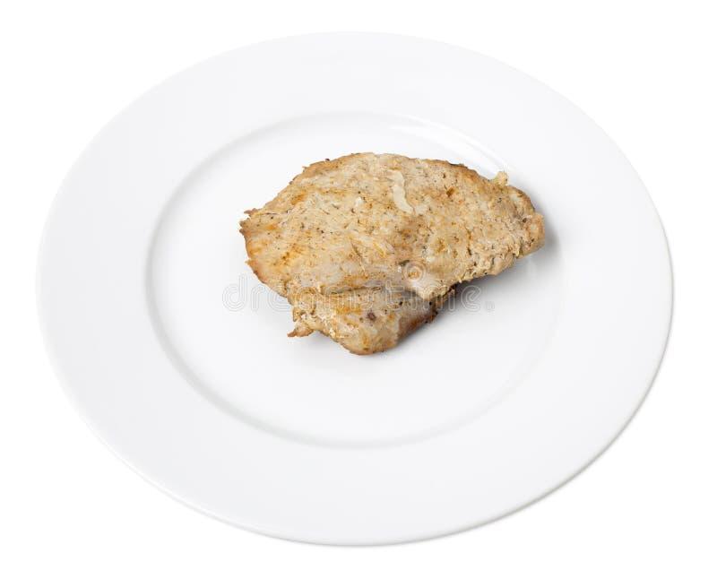 Pollo al forno delizioso in un piatto bianco fotografia stock libera da diritti