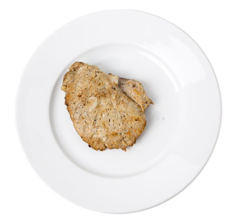 Pollo al forno delizioso in un piatto bianco fotografia stock