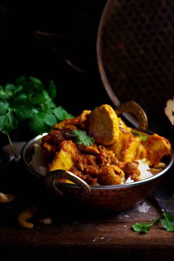 Pollo del curry della zucca sopra il riso dell'anacardio fotografia stock