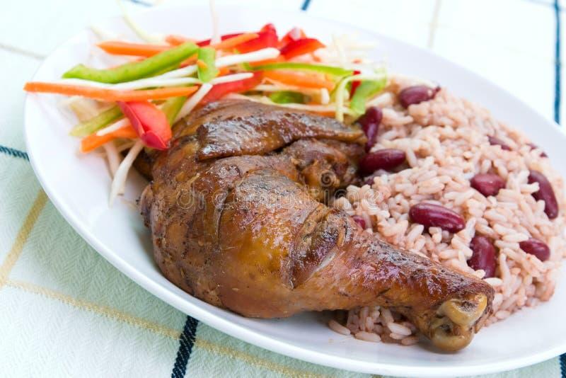 Pollo del tirón con el arroz - Carib fotos de archivo