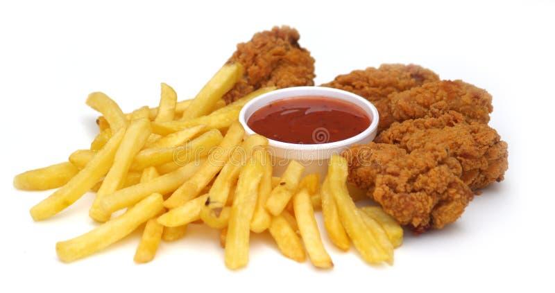 Pollo frito y virutas foto de archivo libre de regalías