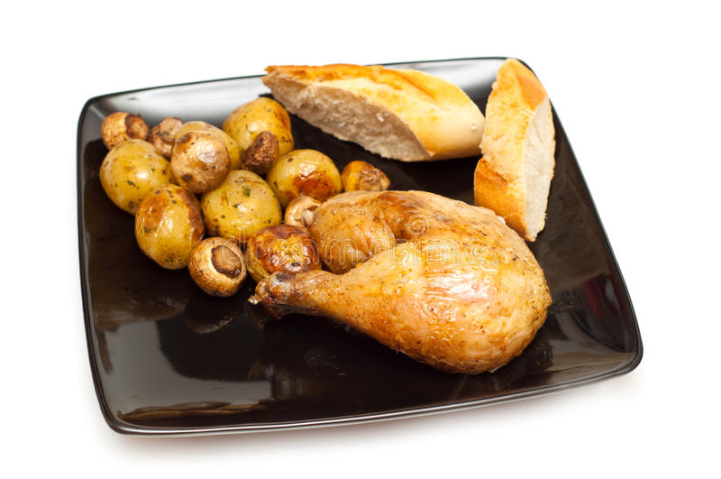 Pollo, pane e patate cotti fotografia stock