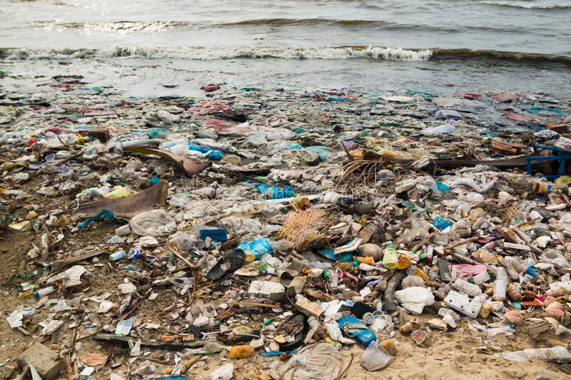 Polluted beach in a fishing village in Vietnam, environmental pollution concept stock image