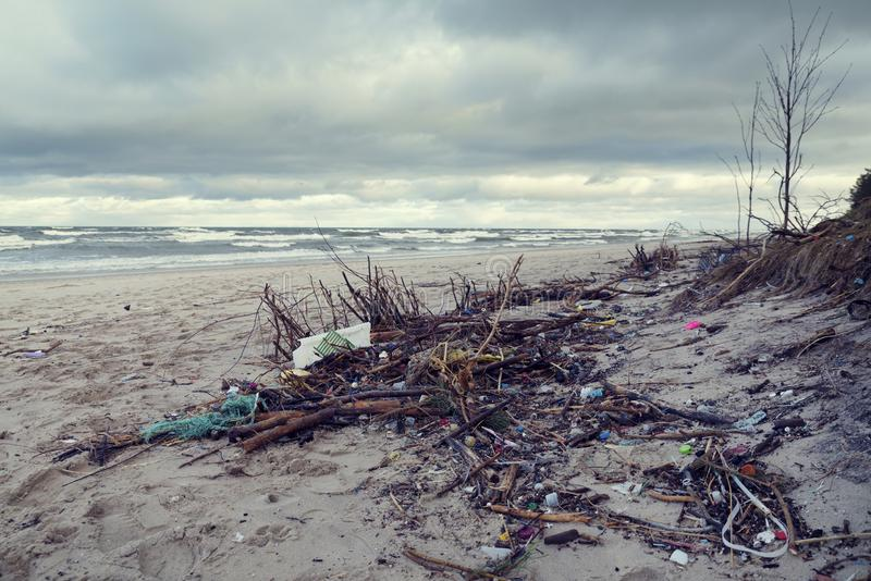 Polluted beach in the North Poland Different kind of waste castaway after a sea storm. Selective focus stock images