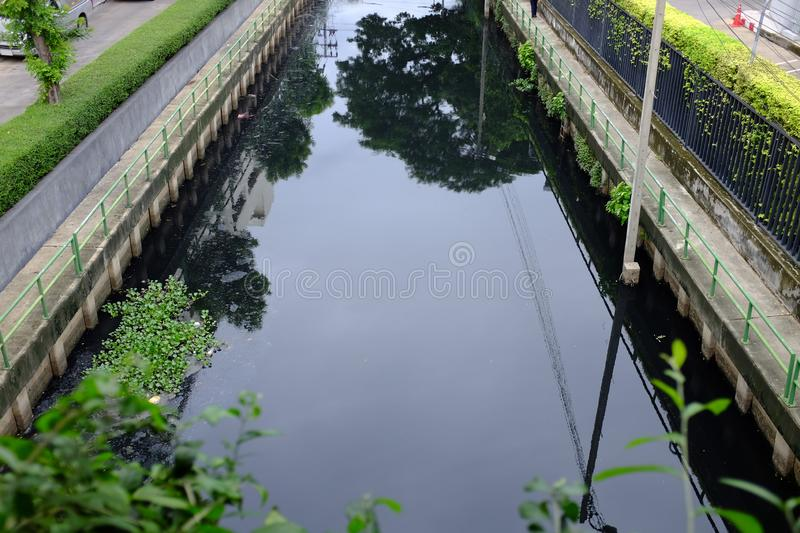 Polluted canal and dirty sewer in an urban area in Bangkok thailand. Polluted water and garbage are serious subject of Thailand.  royalty free stock photos