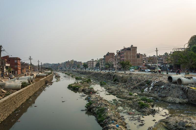 Polluted river in the center of the city on March 25, 2018 in Kathmandu, Nepal. stock images