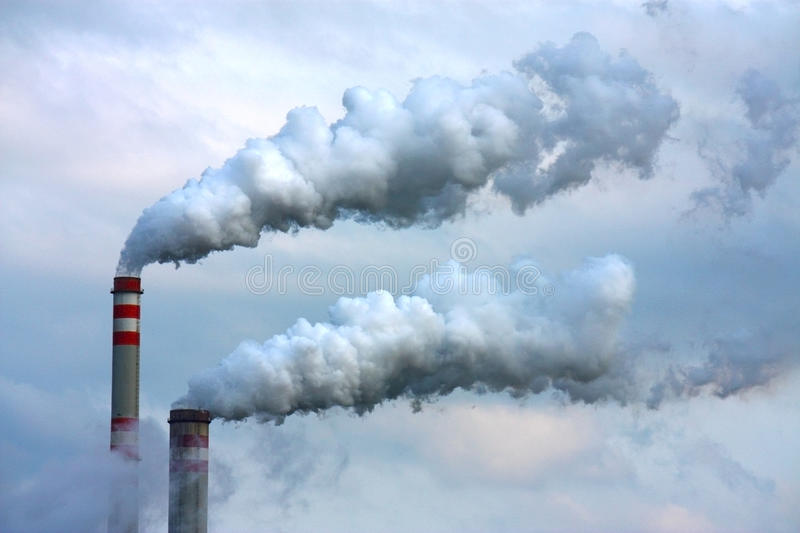 Polluted smoke from oil refinery royalty free stock images