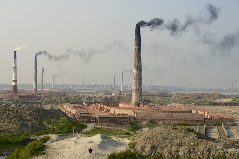 Polluting air brick factories pipes at Dhaka, Bangladesh. stock photography