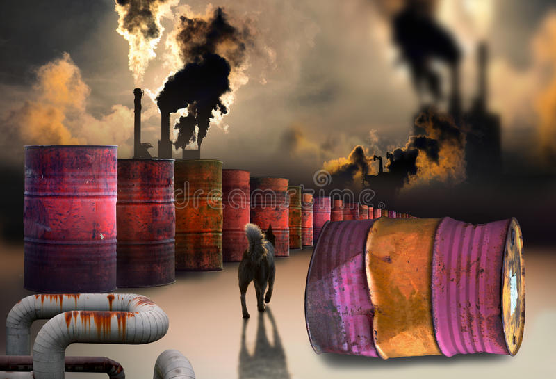 Polluting factory. Row of oil barrels with chimneys and heavy smoke in background, A stray dog casting shadow stock photography