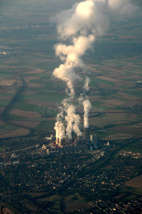 Pollution?. View out of an airplane on industry area stock photos