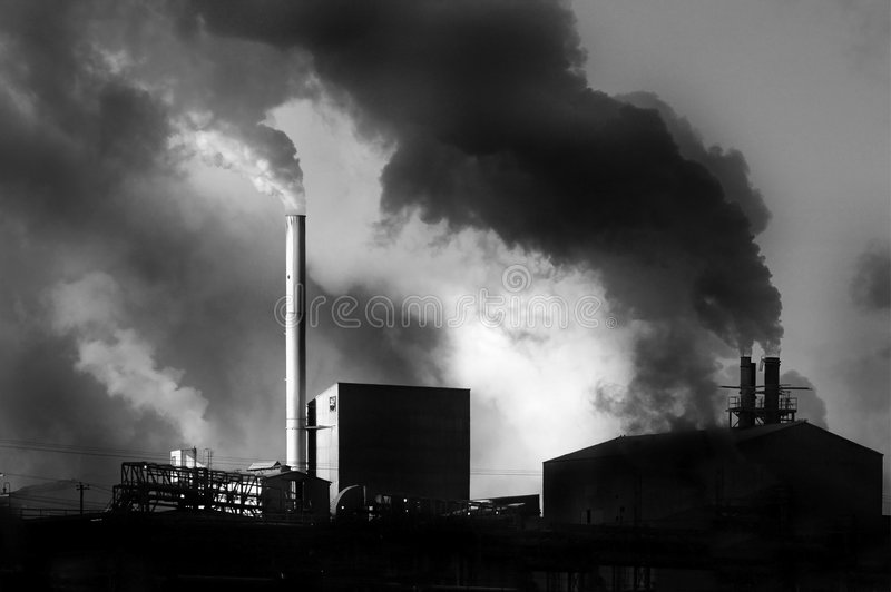 Pollution. Detail of pollution coming from factory smoke stacks stock photography