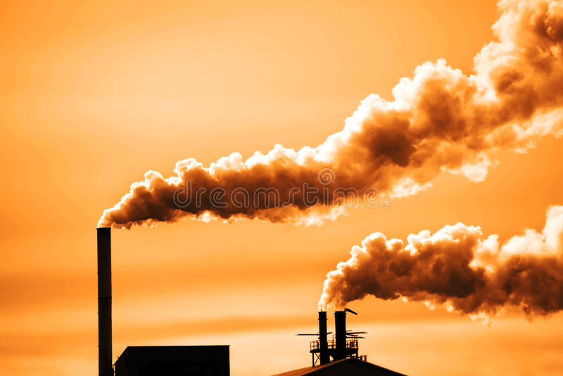 Pollution in the Air. Detail of pollution coming from factory smoke stacks royalty free stock photos