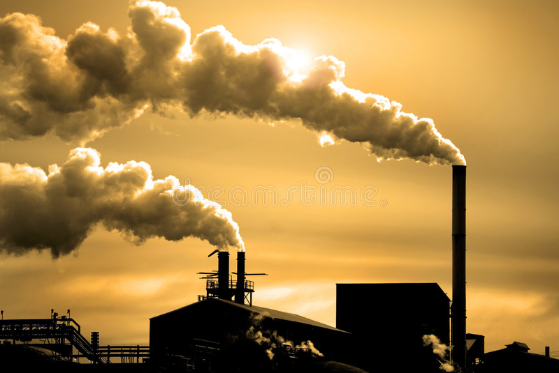 Pollution in the Air. Detail of pollution coming from factory smoke stacks stock images