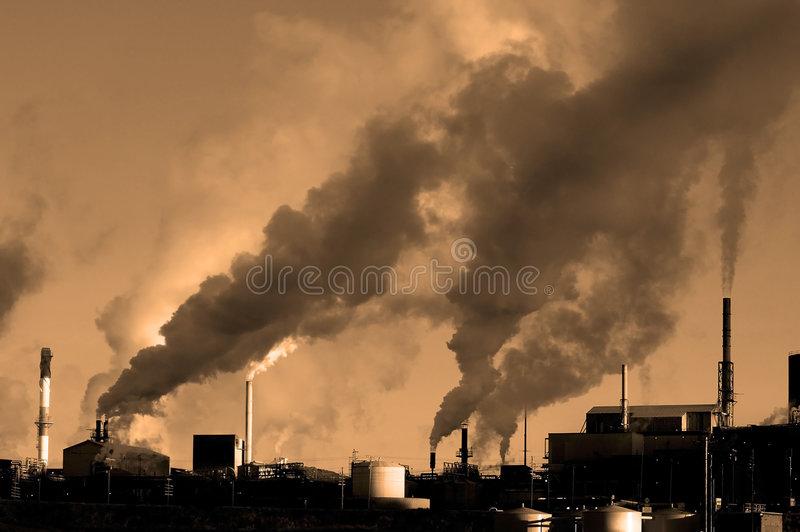 Pollution in the Air. Detail of pollution coming from factory smoke stacks royalty free stock photo