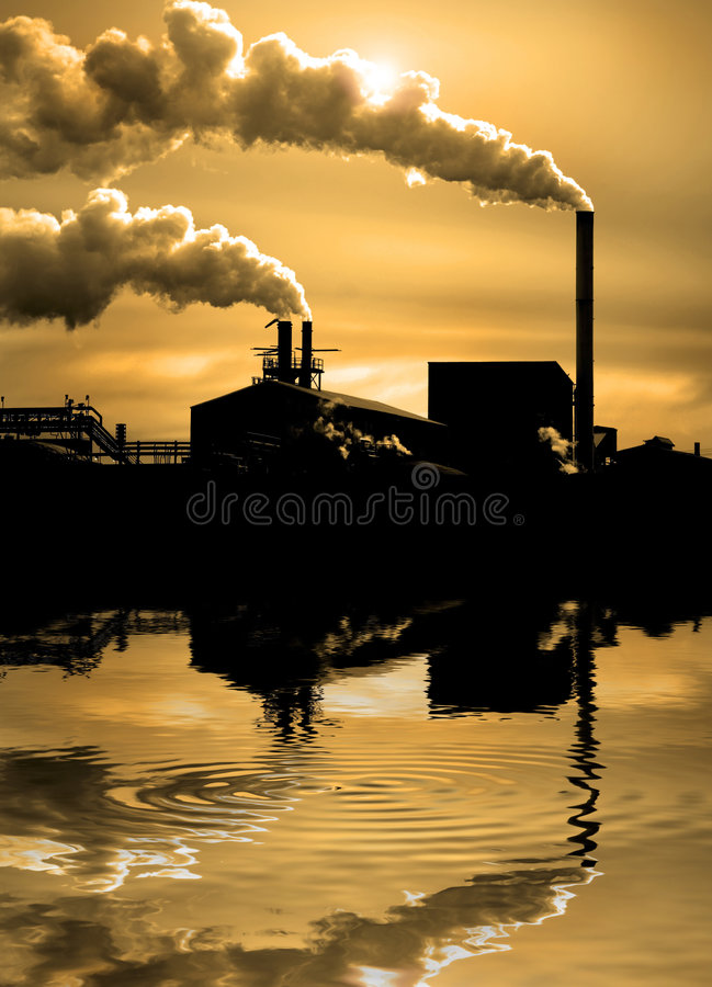 Pollution in the Air. Detail of pollution coming from factory smoke stacks stock photography