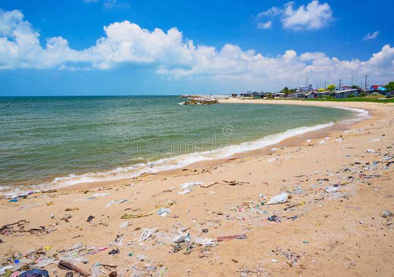 Pollution on the beach of tropical sea. royalty free stock photos
