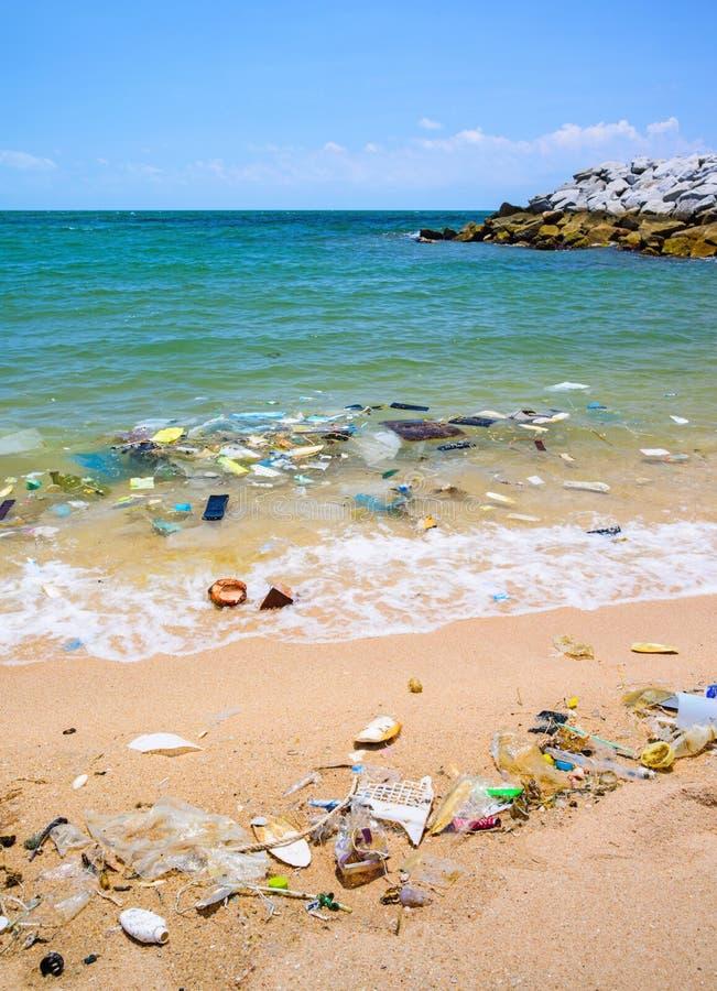 Pollution on the beach of tropical sea. stock photos
